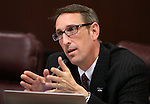 Nevada Sen. Scott Hammond, R-Las Vegas, works in committee at the Legislative Building, in Carson City, Nev., on Wednesday, Feb. 18, 2015. <br /> Photo by Cathleen Allison