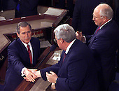 United States President George W. Bush shakes hands with U.S. House Speaker Dennis Hastert (Republican of Illinois) as U.S. Vice President Dick Cheney looks after delivering his message to a Joint Session of Congress in Washington, D.C. on February 27, 2001.<br /> Credit: Consolidated News Photos