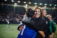 Seattle, Washington -  Sunday, September 11 2016: Seattle Reign FC goalkeeper Hope Solo (1) celebrates with Seattle Reign FC midfielder Keelin Winters (11) after a regular season National Women's Soccer League (NWSL) match between the Seattle Reign FC and the Washington Spirit at Memorial Stadium. Seattle won 2-0.