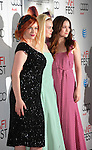 HOLLYWOOD, CA - NOVEMBER 07: Christina Hendricks, Elle Fanning, and Alice Englert arrive at the 'Ginger And Rosa' special screening during AFI Fest 2012 at Grauman's Chinese Theatre on November 7, 2012 in Hollywood, California.