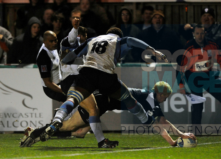 Newcastle's Tom Dillon plants the ball down for his try.