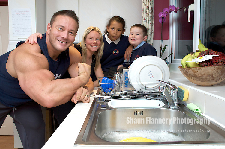 Pix: Shaun Flannery/shaunflanneryphotography.com...COPYRIGHT PICTURE>>SHAUN FLANNERY>01302-570814>>07778315553>>..10th November 2009...........'House husband' and Mr Universe, Dave Titterton of Harthill nr. Worksop, relaxes at home with his family..Wife Cheryl, daughter and son