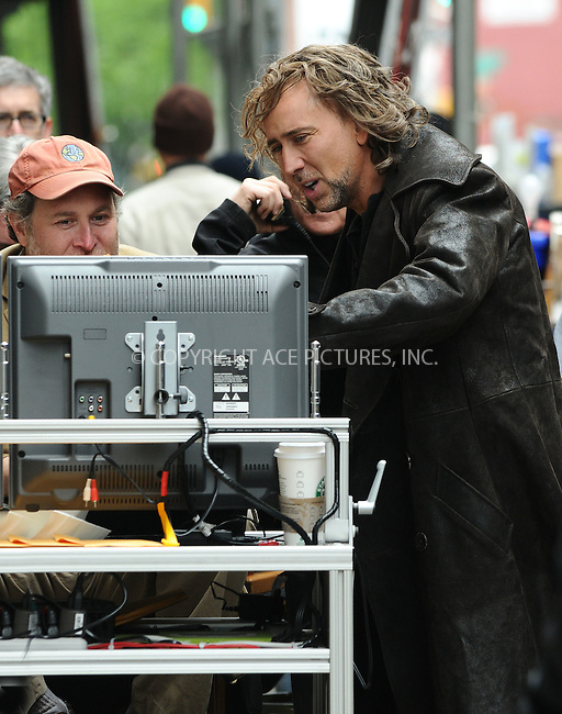 WWW.ACEPIXS.COM . . . . .  ....May 26 2009, New York City....Actor Nicolas Cage and director Jon Turteltaub (L) were on the Manhattan set of the new movie 'The Sorcerer's Apprentice' on May 26 2009 in New York city....Please byline: AJ Sokalner - ACEPIXS.COM..... *** ***..Ace Pictures, Inc:  ..tel: (212) 243 8787..e-mail: info@acepixs.com..web: http://www.acepixs.com