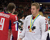 Viacheslav Buravchikov (Ak Bars Kazan), Bryan Little (Cambridge, ON - Barrie Colts) - Team Canada (gold), Team Russia (silver) and Team USA line up for the individual awards and team medal presentations following Team Canada's 4-2 victory over Team Russia to win the gold in the 2007 World Championship on Friday, January 5, 2007 at Ejendals Arena in Leksand, Sweden.
