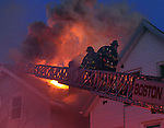 Boston firefighters battle a blaze along Lexington Street in East Boston on Wednesday, April 09, 2014. Photo by Christopher Evans