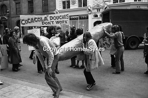 Gay Liberation Front demonstration agains Dr David Reubens book published by Pan Books. central London 1971. A 12-foot papier-mache cucumber was delivered to the offices of Pan Books in protest at Dr David Reuben's homophobic book, Everything You Always Wanted To Know About Sex, which suggested that all gay men were obsessed with shoving vegetables up their bums