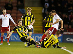 Che Adams of Sheffield Utd has his shot blocked by Shane Cansdell-Sherriff and Tom Naylor of Burton Albion - English League One - Sheffield Utd vs Burton Albion - Bramall Lane Stadium - Sheffield - England - 1st March 2016 - Pic Simon Bellis/Sportimage