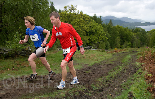 16 MAY 2009 - KESWICK,GBR - Kath Brierley and Paul Bennett make their way to Walla Crag during the Keswick Mountain Festival Triathlon .(PHOTO (C) NIGEL FARROW)