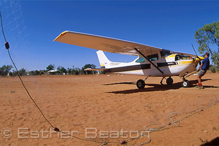 "Pilot Mark O'Kane with plane at ""Bulloo Downs"" station, near Thargomindah, outback Queensland."