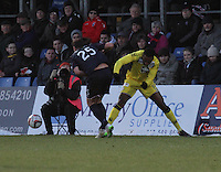 Yoann Arquin about to get the red card after tackling Lewis Toshney  in the Ross County v St Mirren Scottish Professional Football League match played at the Global Energy Stadium, Dingwall on 17.1.15.