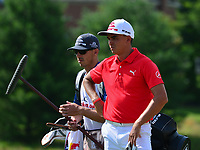Potomac, MD - June 29, 2017: Rickie Fowler and caddie Joe Skovron wait to play a shot on hole 14 during Round 1 of professional play at the Quicken Loans National Tournament at TPC Potomac at Avenel Farm in Potomac, MD, June 29, 2017.  (Photo by Don Baxter/Media Images International)