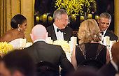 United States President Obama, First Lady Michelle Obama, and Prime Minister Lee Hsien Loong laugh during the State Dinner in the East Room of the White House in Washington, DC on Tuesday, August 2, 2016. <br /> Credit: Leigh Vogel / Pool via CNP