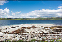 BNPS.co.uk (01202 558833)<br /> Pic:  Strutt&Parker/BNPS<br /> <br /> A stunning Scottish island has emerged for sale for just £1.4million - the cost of a London terraced home.<br /> <br /> Inchmarnock, at the northern end of the Sound of Bute in the Firth of Clyde, is 2.5 miles long, half a mile wide and has 4.75miles of coastline.<br /> <br /> The 660 acre island has a fascinating history, having been a target of Viking raids and used as a D-Day training ground - with bomb craters still visible in its landscape.<br /> <br /> A farmer even discovered the remains of a local Bronze Age woman, the Queen of the Inch, on the island in the 1960s. She lay in a stone cist wearing a black lignite necklace and carrying a flint dagger.