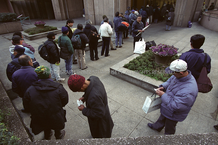1/30/1999--Tokyo, Japan..Homeless Japanese men line up for free soup from the government office in Tokyo's Shinjuku Ward. As Japan's long economic stagnation continues, record numbers of people have been thrown on to the streets....All photographs ©2003 Stuart Isett.All rights reserved.This image may not be reproduced without expressed written permission from Stuart Isett.