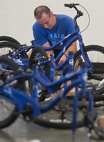 NWA Democrat-Gazette/ANTHONY REYES &bull; @NWATONYR<br /> Kyle McGenley, with Sonora Elementary School, assembles a 20-inch bike Wednesday, Aug. 12, 2015 at Sonora Elementary School in Springdale. The school purchased 32 bikes through a grant from the Walton Family Foundation for use in the school physical education department.