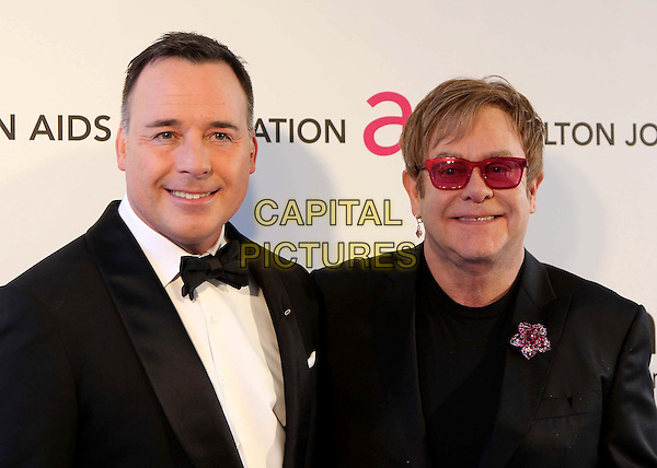 David Furnish, Elton John.The 21st Annual Elton John AIDS Foundation Academy Awards Viewing Party held at The City of West Hollywood Park in West Hollywood, California, USA..February 24th, 2013.oscars headshot portrait suit tuxedo white shirt couple life partners pink sunglasses shades brooch flower black .CAP/ADM/KB.©Kevan Brooks/AdMedia/Capital Pictures.