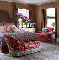 In the master bedroom, a vintage chaise longue is upholstered in a Designers Guild floral and the custom made chair is covered in hand-batiked fabric from Hungry Palette