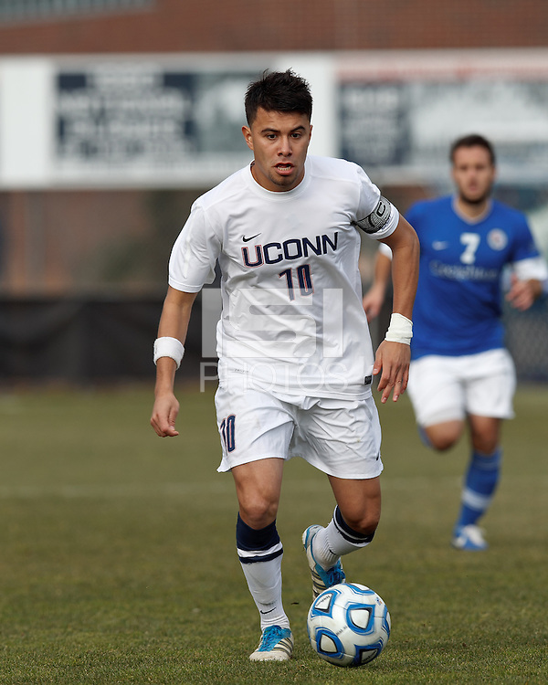 University of Connecticut midfielder Carlos Alvarez (10) brings the ball forward. .NCAA Tournament. Creighton University (blue) defeated University of Connecticut (white), 1-0, at Morrone Stadium at University of Connecticut on December 2, 2012.