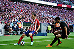 Juanfran Torres of Atletico de Madrid (L) in action against Jose Angel Cote of SD Eibar (R) during the La Liga match between Atletico Madrid and Eibar at Wanda Metropolitano Stadium on May 20, 2018 in Madrid, Spain. Photo by Diego Souto / Power Sport Images