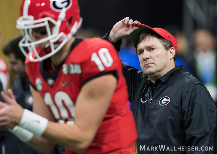 Georgia Bulldogs head coach Kirby Smart watches as Georgia Bulldogs quarterback Jacob Eason (10) goes through his warm ups before the NCAA College Football Playoff National Championship at Mercedes-Benz Stadium on January 8, 2018 in Atlanta. Photo by Mark Wallheiser/UPI
