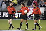 11 December 2009: Match Officials. From left: Assistant Referee Andy Chapin, Match Referee Misail Tsapos, and Assistant Referee Chico Grajeda. The University of Virginia Cavaliers defeated the Wake Forest University Demon Deacons 2-1 after overtime at WakeMed Soccer Stadium in Cary, North Carolina in an NCAA Division I Men's College Cup Semifinal game.