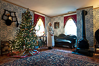 "A re-enactor stands in the front room of the Hanby House in Westerville, Ohio,. the house of the song writer and author is decorated for the Christmas season. The home belonged to Benjamin Hanby who wrote the Christmas Carol ""Up on the rooftop."" The house is on the National Registry of Historical Places."