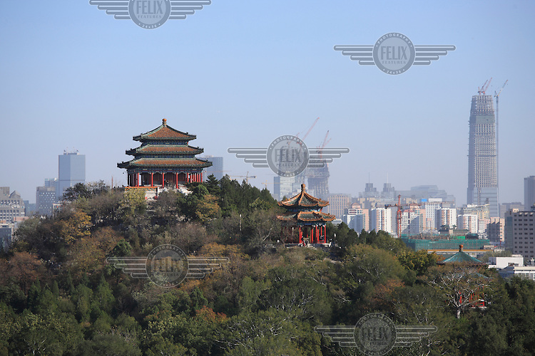Dagaoxuan Temple in Jingshan Park with new high rise construction in the background in Beijing's Central Business District.