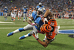 Cincinnati Bengals wide receiver Marvin Jones (82) catches a 12-yard touchdown reception as Detroit Lions cornerback Chris Houston (23) defends in the second quarter of an NFL football game against Sunday, Oct. 20, 2013, in Detroit. (AP Photo/Jose Juarez)