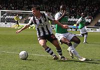 Paul McGowan beats Isaiah Osbourne in the St Mirren v Hibernian Clydesdale Bank Scottish Premier League match played at St Mirren Park, Paisley on 29.4.12.