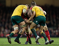Wales' Alun Wyn Jones under pressure from Australia's Sean McMahon<br /> <br /> Photographer Simon King/CameraSport<br /> <br /> International Rugby Union - 2017 Under Armour Series Autumn Internationals - Wales v Australia - Saturday 11th November 2017 - Principality Stadium - Cardiff<br /> <br /> World Copyright &copy; 2017 CameraSport. All rights reserved. 43 Linden Ave. Countesthorpe. Leicester. England. LE8 5PG - Tel: +44 (0) 116 277 4147 - admin@camerasport.com - www.camerasport.com