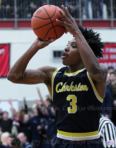 C.J. Robinson, Clarkston, goes up goes up for a three during Class A quarterfinal basketball action at Grand Blanc High School Tuesday, March 20, 2018. Robinson scored 12-points to help Clarkston defeat the Cavaliers 52-31. Photos: Larry McKee, L McKee Photography. PLEASE NOTE: ALL PHOTOS ARE CUSTOM CROPPED. BEFORE PURCHASING AN IMAGE, PLEASE CHOOSE PROPER PRINT FORMAT TO BEST FIT IMAGE DIMENSIONS. L McKee Photography, Clarkston, Michigan. L McKee Photography, Specializing in Action Sports, Senior Portrait and Multi-Media Photography. Other L McKee Photography services include business profile, commercial, event, editorial, newspaper and magazine photography. Oakland Press Photographer. North Oakland Sports Chief Photographer. L McKee Photography, serving Oakland County, Genesee County, Livingston County and Wayne County, Michigan. L McKee Photography, specializing in high school varsity action sports and senior portrait photography.