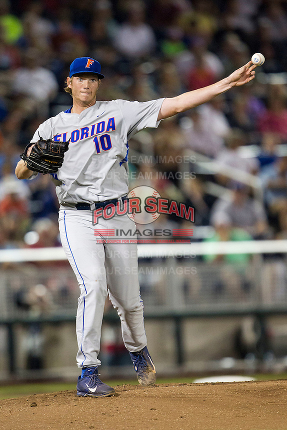 Florida Gators starting pitcher A.J. Puk (10) makes a pickoff throw to first base during the NCAA College baseball World Series against the Virginia Cavaliers on June 15, 2015 at TD Ameritrade Park in Omaha, Nebraska. Virginia defeated Florida 1-0. (Andrew Woolley/Four Seam Images)