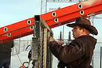 Ammon Bundy unties a ladder used to remove two FBI surveillance cameras found at a power station near the Malheur National Wildlife Reserve on January 15, 2016 in Burns, Oregon.  Bundy and about 20 other protesters took over the refuge on Jan. 2 after a rally to support the imprisoned local ranchers Dwight Hammond Jr., and his son, Steven Hammond. Another surveillance camera was found near the reserve.  ©2016. Jim Bryant Photo. All Rights Reserved.