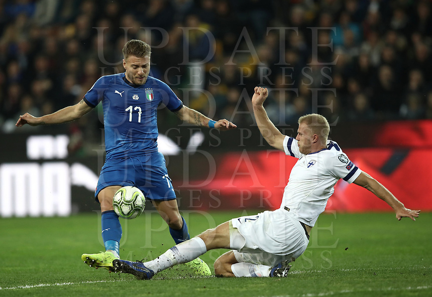 Football: Euro 2020 Group J qualifying football match Italy vs Finland at the Friuli Stadium in Udine on march  23, 2019<br /> Italy's Ciro Immobile (l) in action with Finland's Paulus Arajuuri (r) during the Euro 2020 qualifying football match between Italy and Finland at the Friuli Stadium in Udine, on march 23, 019<br /> UPDATE IMAGES PRESS/Isabella Bonotto