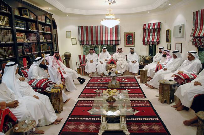 Sheik Adel Al-Nawada, a Salafi member of parliament, (seated 2nd from left kissing his son), held a majlis at his home in Manama, the Bahraini capital, December 13, 2005.