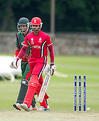 ICC World T20 Qualifier - GROUP B MATCH - CANADA V KENYA at Watsonians CC, Edinburgh - in step, with different emotions - Canada batsman Ravindu Gunasekera goes for 51 after being bowled in front of Kenya keeper Irfan Karim — credit @ICC/Donald MacLeod - 10.07.15 - 07702 319 738 -clanmacleod@btinternet.com - www.donald-macleod.com
