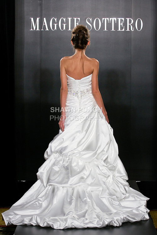 Model walks the runway in a Mercedes Couture wedding dress from the Maggie Sottero Bridal Spring 2012 collection, during  Couture: New York Bridal Fashion Week 2012