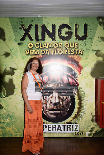 "Rio de Janeiro, Brazil. Imperatriz Leopoldinense samba school; preparations for carnival. Activist Antonia Melo stands in front of a poster which says ""Xingu, the call which comes from the forest""."