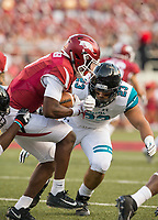 Hawgs Illustrated/BEN GOFF <br /> De'Vion Warren, Arkansas wide receiver, braces for a hit from Lorenzo D'Angelo (23) of Coastal Carolina, while returning a kickoff in the third quarter Saturday, Nov. 4, 2017, at Reynolds Razorback Stadium in Fayetteville.