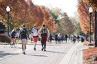 Old Main Plaza fall leaves: students walking. (photo by Megan Bean / © Mississippi State University)