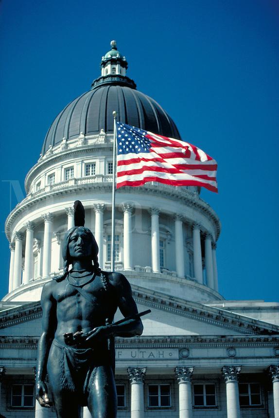 Utah State Capitol Building Dome, American flag, and statue of Native American Indian, Salt Lake City. Salt Lake City, Utah.