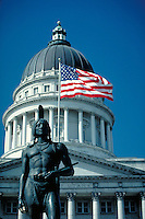 Utah State Capitol Building Dome, American flag, and statue of Native American Indian, Salt Lake City. Salt Lake City, Utah.