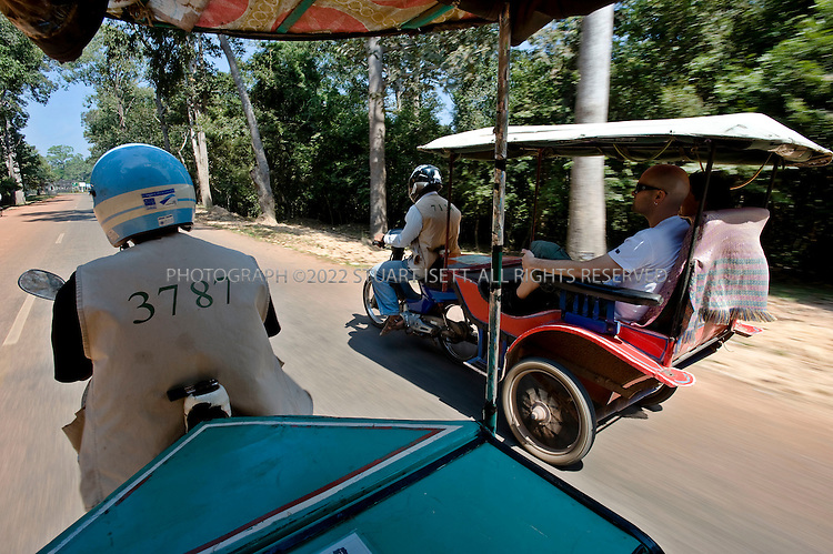 11/28/2008--Siem Reap Province, Cambodia..The best way to see the temples in a group is by 'tuk-tuk' which can be rented from $10-15 a day depending on the distance...©2008 Stuart Isett. All rights reserved.