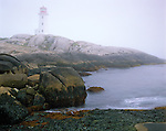 Halifax County, Nova Scotia, Canada:  Peggy's Point Lighthouse at Peggy's Cove in thick fog, at the entrance to Saint Margarets Bay