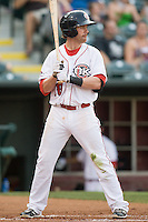 Oklahoma City RedHawks left fielder Jake Elmore (10) at bat during the Pacific Coast League game against the Omaha Storm Chasers at Chickashaw Bricktown Ballpark on June 23, 2013 in Oklahoma City ,Oklahoma.  (William Purnell/Four Seam Images)