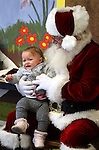 Chloe Machado, 1, sits with Santa during Storytime at the Carson City Library on Thursday, Dec. 13, 2012. .Photo by Cathleen Allison
