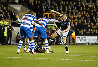 Steve Morison tries to get the ball with George Saville of Millwall prone on the floor during the Sky Bet Championship match between Millwall and Queens Park Rangers at The Den, London, England on 29 December 2017. Photo by Carlton Myrie / PRiME Media Images.