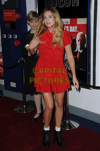 Keeley Hazell.The 'St George's Day' world film premiere, Odeon Covent Garden cinema, Shaftesbury Avenue, London, England..August 29th, 2012.full length red dress black boots white socks hand arm.CAP/CAS.©Bob Cass/Capital Pictures.
