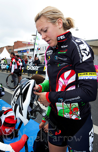 22 MAY 2011 - DUNKERQUE, FRA - Vicky Holland (Charleville Triathlon Ardennes) prepares her bike helmet and sunglasses before the start of the women's round of the 2011 French Grand Prix triathlon series (PHOTO (C) NIGEL FARROW)