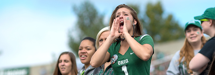 Ariel Stiggers cheers for OHIO at the 2013 Homecoming football game. Photo by Ben Siegel